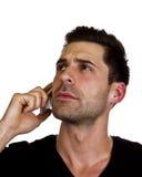 年轻人在电话谈话 库存照片