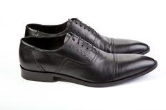 人在白色背景的` s鞋子 免版税库存图片