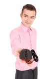 年轻人在他的手黑色计算机光电鼠标举行 库存图片