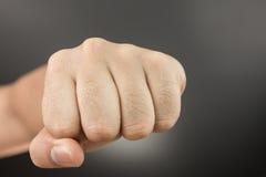 人在黑色的拳打拳头 免版税库存照片