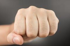人在黑色的拳打拳头 免版税图库摄影