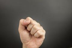 人在黑色的拳打拳头 图库摄影