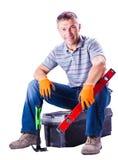 人坐有工具的一个箱子 免版税库存图片