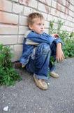 人坐的年轻人 免版税图库摄影