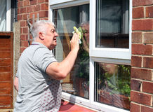 窗户清洁。 免版税图库摄影
