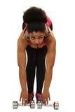 黑人女孩执行与哑铃的锻炼 库存照片