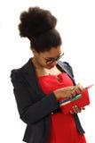 黑人女孩从钱包得到金钱 免版税图库摄影