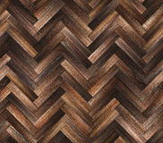 人字形自然黑暗的木条地板无缝的地板纹理 库存照片