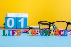 人寿保险,家庭服务,支持的概念 词组成由在企业工作场所的小色的信件  免版税图库摄影