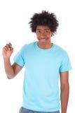 年轻黑人少年学生人写在屏幕的-非洲人 免版税库存照片