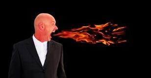 人尖叫与从嘴出来的火焰 免版税库存图片