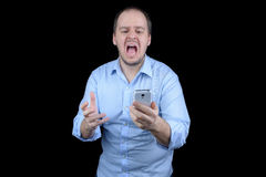 年轻人尖叫对手机 免版税库存照片