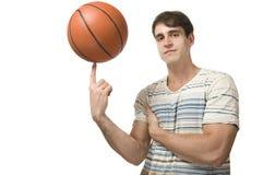 人平衡篮球 免版税图库摄影
