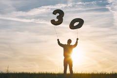人庆祝三十年生日 免版税库存照片