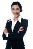 年轻人微笑的母用户支持职员 库存图片