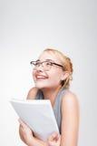 年轻人微笑的白肤金发愉快关于巨大成功 免版税图库摄影