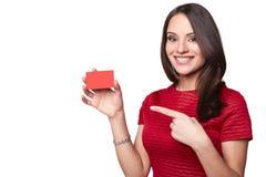 年轻人微笑的美好性感妇女显示空 库存图片