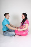 人怀孕的坐的妇女 库存图片