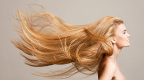 令人惊讶的流动的头发 库存照片