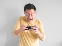 人愤怒地打比赛 免版税库存图片