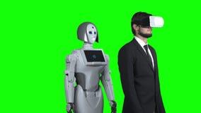 人戴着眼镜虚拟现实把他的手放到一边,并且机器人在他以后重复 绿色屏幕 股票录像