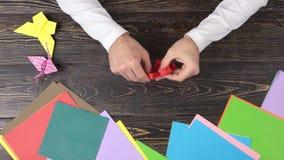 人折叠的莲花的手从纸的 股票视频