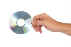 人拿着compakt圆盘 免版税库存图片