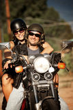 人摩托车妇女 免版税库存照片