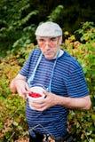人收集莓 库存图片