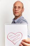人显示有心脏的笔记本组织者 库存照片