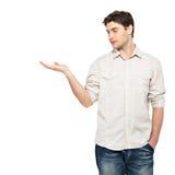 人显示某事在白色查出的掌上型计算机 免版税库存照片