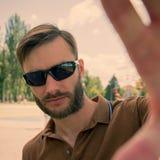 人有胡子的和戴眼镜禁止拍照片 免版税库存照片