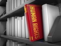 人权-红色书的标题 库存照片