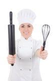 年轻人烹调制服的妇女有烘烤被隔绝的滚针的  库存照片