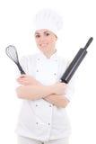 年轻人烹调制服的妇女有烘烤滚针和花冠的 库存照片