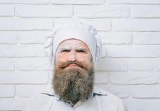 人用在面孔的面粉 免版税库存图片