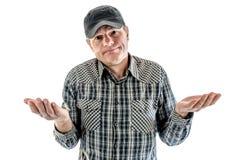 人用帽子被举的手 免版税库存照片