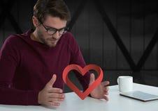 人用开放手和心脏由办公室窗口 图库摄影
