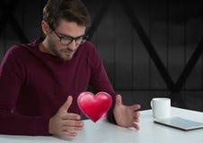 人用开放手和心脏由办公室窗口 免版税库存图片