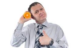 人用桔子 免版税图库摄影