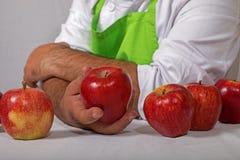 人用红色苹果 库存照片