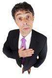 人用他的对他的心脏的手 免版税图库摄影