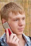 人由电话讲话 库存照片