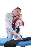 人电烙,并且抱着婴孩 免版税库存照片