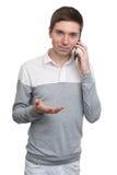 人电话联系的年轻人 库存照片