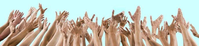 人的和被举的妇女的手  免版税库存照片