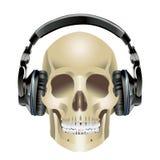 人的头骨和耳机 免版税库存图片