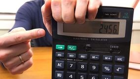 人的对数额的手点在计算器 影视素材