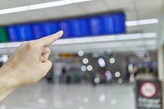 人的手指指向迷离航行时刻表 图库摄影