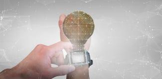 人的播种的图象的综合图象使用手表的 免版税库存照片
